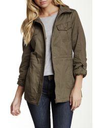 Jessica Simpson - Embroidered Sleeve Rain Coat - Lyst