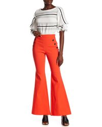 Jealous Tomato - Button Flared Jeans - Lyst