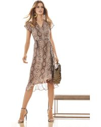 e39cdd80923 New York   Company - Snake-print Ruffle Wrap Dress - Sweet Pea - Lyst