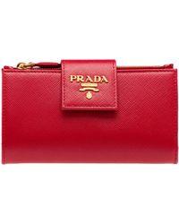 bd9eca9b344a Lyst - Prada Saffiano Leather Zip Around Wallet in Pink