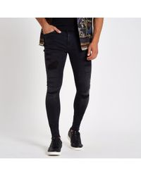 River Island - Ollie Rip Super Skinny Spray On Jeans - Lyst