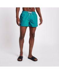 River Island - Green Chilli Print Short Swim Shorts - Lyst