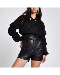 5750ffca126 River Island Black Bow Front Bell Sleeve Bardot Top in Black - Lyst