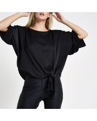River Island - Petite Black Loose Fit Knot Front Top - Lyst
