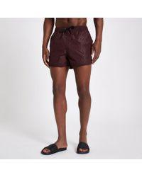 River Island - Burgundy Triangle Embossed Runner Swim Shorts - Lyst