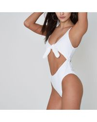 River Island - White Textured Knot Front Cut Out Swimsuit - Lyst