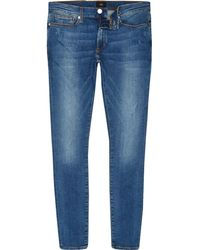River Island - Mid Ollie Spray On Faded Skinny Jeans - Lyst