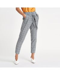 River Island - Petite Black Check Tapered Pants - Lyst