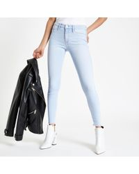 River Island - Light Blue Molly Frayed jeggings - Lyst