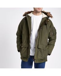 River Island - Lee Dark Green Faux Fur Trim Parka Jacket - Lyst