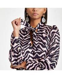 River Island - Zebra Print Tie Neck Blouse - Lyst