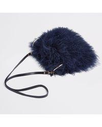 Lyst - Boohoo Skye Mongolian Faux Fur Clutch Bag in Black c719f19ebb
