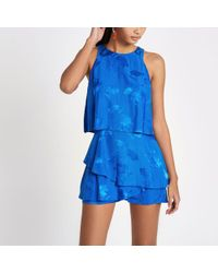 River Island - Blue Floral Tiered Playsuit Blue Floral Tiered Playsuit - Lyst