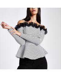 River Island - Stripe Long Sleeve Peplum Bardot Top - Lyst