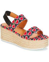 5e266282fccf Love Moschino Women S Tassel Jelly Sandals in Black - Lyst