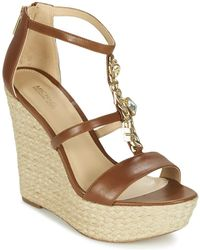 1ef5f12a1e6 Michael Michael Kors Willa Wedge Heeled Sandals in Pink - Lyst