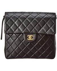 Chanel - Black Quilted Lambskin Leather Flap Backpack - Lyst