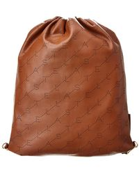 90e0086cd6f7 Michael Kors Rhea Mini Perforated Leather Backpack in Pink - Lyst