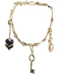 Louis Vuitton - Louis Vuitton 18k Two-tone Peridot Charm Bracelet - Lyst