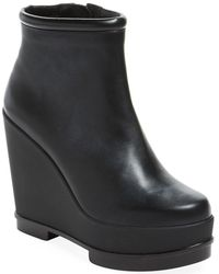 44be019360f1 Lyst - Robert Clergerie Fille Leather Wedge Ankle Boots in Black