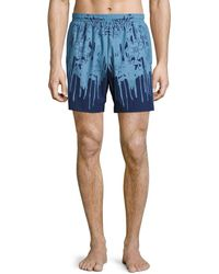 a357bb9cfb Alexander Mcqueen Letters From India Swim Shorts in Natural for Men ...