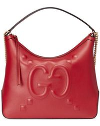 ffb266f968e30d Gucci - Leather Tote With Embossed GG In Red - Lyst