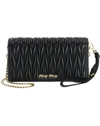 07b370f4f681 Miu Miu Bandoliera Madras Crossbody Bag Small Nero in Black - Lyst