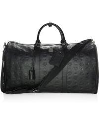 MCM - Embossed Leather Duffel Bag - Lyst