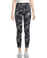 bb880581ffc190 PUMA - Rebel Aop Floral Print Leggings - Lyst