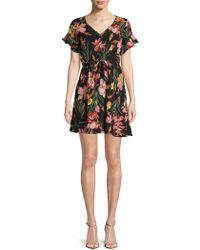 Haute Rogue - Ruffled Floral Mini Dress - Lyst