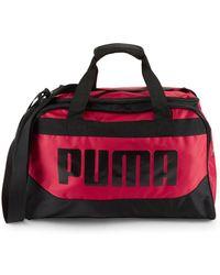 PUMA - Transformation Camouflage Duffel Bag - Lyst