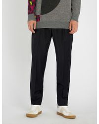 Chalayan - Pinstriped Tapered Woven Trousers - Lyst