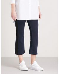 Izzue - Striped-panel Cropped Woven Trousers - Lyst