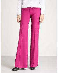 Theory - Demitria High-rise Flared Stretch-wool Trousers - Lyst