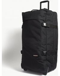 Eastpak - Black Andy Warhol Tranverz Two Wheel Suitcase - Lyst
