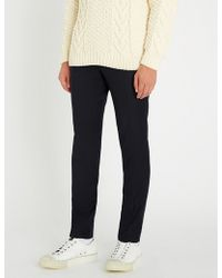 Sandro - Alpha Wool-flannel Tapered-leg Trousers - Lyst