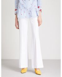 Alice + Olivia - Jalisa Flared Crepe Trousers - Lyst