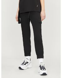 Izzue - Graphic-logo Buckled Shell Trousers - Lyst