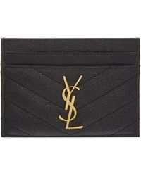 Lyst - Saint Laurent Petite Monogram Quilted Leather Clutch in Black 6a67c273379fc