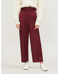 Sandro - Aloes Belted High-rise Wide-leg Cotton-blend Twill Trousers - Lyst