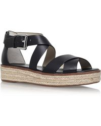 0cdecae163c5 Michael Kors Darby Flat Espadrille Sandals in Black - Lyst