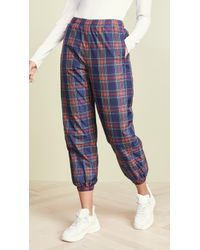 SJYP - Reversible Check Track Trousers - Lyst