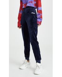 d2388ccb Fila Tonia High Waisted Flared Velour Pant in Black - Lyst