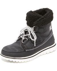 Sorel - Cosy Carnival Women's High Boots In Black - Lyst