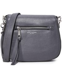 60abd6fbf95b Lyst - Marc Jacobs Nomad Small Studded Saddle Bag in Blue
