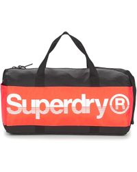 Superdry - Montana Barrel Women's Sports Bag In Black - Lyst