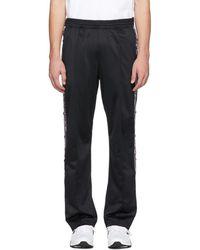 Champion - Black Logo Tape Lounge Pants - Lyst