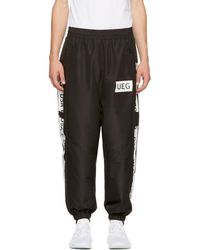 Ueg - Black Logo Tape Track Pants - Lyst