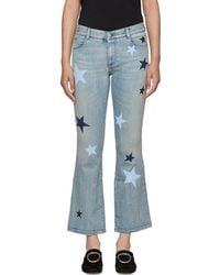 Stella McCartney - Blue Stars Skinny Kick Flare Jeans - Lyst