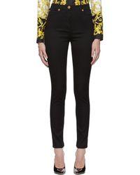 Versace - Black Medusa Stud Skinny Jeans - Lyst